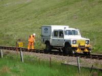 A Network Rail track team with rail mounted Land Rover standing by milepost 43 south of Bridge of Orchy on 26 June 2013. They had approximately 15 minutes left to clear the section by 13.00 for the ex Mallaig service to pass through.<br><br>[David Pesterfield&nbsp;26/06/2013]