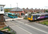 <I>Northern</I> meets <I>Arriva</I> at Redcar Central on 5 June. The Northern 12.53 Darlington - Saltburn train and the Arriva 12.32 Middlesbrough - Redcar bus say hello at West Dyke Road level crossing alongside Redcar Central station.<br><br>[John Furnevel&nbsp;05/06/2013]