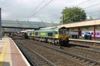 A heavy ballast train is double headed north through Lancaster station on 24 May. Freightliner's 66514 and 66615 are on the Down Through line, probably heading for Carlisle New Yard.<br><br>[Mark Bartlett&nbsp;24/05/2013]