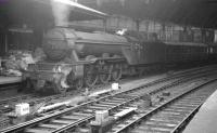 60112 <I>St Simon</I> prepares to leave Newcastle Central on 1 July 1961 with the 8.10am to Kings Cross. Note the experimental small smoke deflectors, which appeared on some A3s following the fitting of double chimneys in the late 1950s. These proved ineffective and were later abandoned in favour of the German-style attachments. [See image 32634]<br><br>[K A Gray&nbsp;01/07/1961]