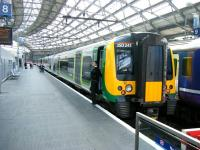 Scene on platform 8 at Liverpool Lime Street station on 21 June 2013. London Midland 350241 is preparing to depart with a service to Birmingham New Street. <br><br>[Veronica Clibbery&nbsp;21/06/2013]