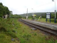 View north at Kildonan Station in June 2013 showing the current up and former down platform. Note the contrasting styles of the old and new waiting shelters.<br><br>[David Pesterfield&nbsp;23/06/2013]