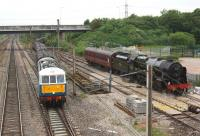 Having changed locos at Farington Junction on 20 June, the return <I>Cumbrian Mountain Express</I> snakes out onto the WCML behind 86259 <I>Les Ross</I> on its way back to Euston. On the right is 46115 <I>Scots Guardsman</I> which had hauled the train from Carlisle and was waiting to return home to Carnforth.<br><br>[John McIntyre&nbsp;20/06/2013]