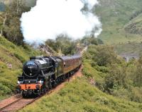 <I>The Jacobite</I>, hauled by Black 5 No 44871, makes light work of the 1 in 50 gradient between Glenfinnan Viaduct and the station on 26 June with the afternoon Fort William - Mallaig service.<br><br>[John Gray&nbsp;26/06/2013]