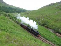 In the shadow of Druim na Brein-choille, west of Glenfinnan station, Ian Riley's 5MT 4-6-0 44871 climbs towards the summit with a <I>Jacobite</I> service for Mallaig in June 2013. <br><br>[Malcolm Chattwood&nbsp;26/06/2013]