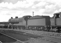 Steam locomotives stored in the yard at Horwich works in June 1963 include class O4 2-8-0 63695 (withdrawn Sheffield Darnall 12/62) and 3F 0-6-0T 47281 (withdrawn Carlisle Kingmoor 3/63).<br><br>[K A Gray&nbsp;22/06/1963]