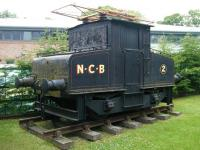 Cosmetically restored Siemens electric shunting locomotive E2 (Works no 455 of 1909), in National Coal Board livery, on a length of track at Beamish Museum in June 2013. No E2 was formerly part of the Harton Coal Company fleet and ended its working life at Westoe Colliery, South Shields, in the 1980s. [See image 18190]<br><br>[Veronica Clibbery&nbsp;11/06/2013]