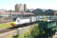 On an unusually hot 4 June 2013, the 12.00 Kings Cross - Inverness <I>Highland Chieftain</I> pulls away from the York stop.<br><br>[John Furnevel&nbsp;04/06/2013]