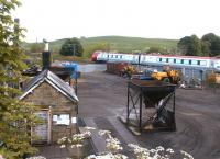 A southbound Voyager passing the goods yard at Alnmouth in May 2004 shortly after leaving the station.<br><br>[John Furnevel&nbsp;26/05/2004]