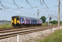 A Northern Class 150 heads past the Leyland Trucks site approaching Farington Junction on 6 July 2013 with a service to Blackpool.<br><br>[John McIntyre&nbsp;06/07/2013]