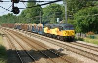Colas Rail Freight 56105+56087 head south on the WCML at Euxton on 6 July with the Carlisle to Chirk loaded log train.<br><br>[John McIntyre&nbsp;06/07/2013]