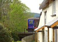 A Class 143 passes Collerton Mill near Kings Nympton on the Tarka Line in April 2011.<br><br>[Ian Dinmore&nbsp;22/04/2011]