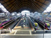 A view north from the footbridge at Southern Cross on 21 May 2013 showing the 'undulating roof', designed by British architect Sir Nicholas Grimshaw - winner of a RIBA prize. The number of VLocity dmus grows apace as they displace loco-hauled services. There is currently political pressure to revert to the former name of 'Spencer Street Station'.<br><br>[Colin Miller&nbsp;21/05/2013]