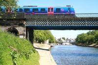 Looking south along the Ouse towards Lendal Bridge on 6 June, with the 13.48 TransPennine service from Scarborough to Liverpool Lime Street about to cross the river and enter York station.<br><br>[John Furnevel&nbsp;06/06/2013]