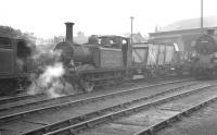 Busy scene in the shed yard at Brighton in the summer of 1961. Centre stage is departmental locomotive DS377 <I>'Brighton Works'</I>. The 0-6-0T <I>Terrier</I> (previously numbered 32635) was built at the nearby works in 1878. On the left is Billinton 0-6-2 Radial Tank 32580, another product of the same works in 1903. The relatively modern member of the trio, BR Standard class 4 2-6-4T 80068 was built here in 1953. <br><br>[K A Gray&nbsp;14/08/1961]