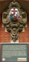 Merged images showing the crest of the North Eastern Railway on its former York Headquarters. The board below explains the origin of the three shields that form the crest.<br><br>[John McIntyre&nbsp;13/07/2013]