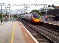 A down Pendolino rushes through Bletchley on a hot Monday evening in July 2013.<br><br>[Ken Strachan&nbsp;15/07/2013]