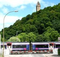 Waterside level crossing at Causewayhead, just to the east of Stirling. Scene in June 2008, some 3 weeks after recommencement of passenger services between Alloa and Stirling. Speeding east over the crossing is the 1218 Glasgow Queen Street - Alloa. [See image 56554]<br><br>[John Furnevel&nbsp;12/06/2008]