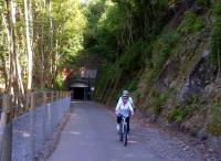 A below-average number of cyclists enjoying smooth new tarmac as they leave the south portal (near Midford) of Combe Down tunnel, which is internally lit from 5am to 11pm; and offers music while you ride. See image [[35576]]<br><br>[Ken Strachan 07/07/2013]