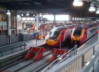 All systems go at Euston station during the evening rush hour on 12 July 2013, with two Voyagers sandwiching two Pendolinos at the platforms.<br><br>[Ken Strachan&nbsp;12/07/2013]