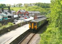The 11.44 Northern service to Whitby arrives at Grosmont platform 1 off the Esk Valley line on a hot and humid 6 June. The train has approximately 20 minutes remaining of its journey from Middlesbrough. Platforms 2-4, which handle NYMR services, are off to the left.<br><br>[John Furnevel&nbsp;06/06/2013]