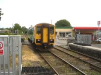 Arriva Trains Wales single car unit 153353 runs north over the level crossing on departure from Llandovery on 16 July as it heads back to Shrewsbury with the 09.15 ex Swansea <I>Heart of Wales Line</I> service.<br><br>[David Pesterfield&nbsp;16/07/2013]