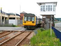 The 12.58 Saltburn - Darlington DMU takes the level crossing over West Dyke Road and enters Redcar Central station on 5 June 2013.<br><br>[John Furnevel&nbsp;05/06/2013]