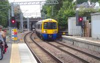 A train for Stratford arriving at Highbury and Islington from the west on 20 July 2013.<br><br>[John Thorn&nbsp;20/07/2013]