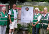 Volunteers at Milngavie station alongside the <I>Milngavie in Bloom</I> poster currently on display there. A small exhibition to commemorate the 150th Anniversary of Milngavie station is to be held in the nearby Town Hall from 10th-14th September alongside displays showing the work of some of the Milngavie clubs and societies during that period. It will also be part of East Dunbartonshire Doors Open Day on 14th September.<br><br>[John Yellowlees&nbsp;27/07/2013]