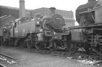 BR Standard class 2 2-6-2T 84008 in the shed yard at Kentish Town in October 1962.<br><br>[K A Gray&nbsp;28/10/1962]