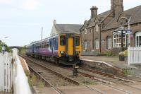 156426, on a Carlisle to Barrow service, calls at the Drigg request stop on the Cumbrian Coast line. The station building is now used as a craft and coffee shop. The rail served BNFL facility at Drigg lies alongside the station.<br><br>[Mark Bartlett&nbsp;27/07/2013]