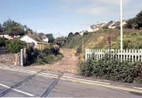 Level crossing remains at Instow in 1990 looking towards Barnstaple. The former Instow station, closed to passengers in 1965, stands on the other side of Marine Parade behind the camera. The line closed completely in 1982 and the trackbed is now part of <I>The Tarka Trail</I>.<br><br>[Ian Dinmore&nbsp;//1990]