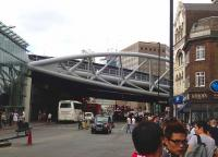 View north east along Borough High Street SE1 on 20 July 2013 towards the new viaduct. Just beyond, the lines from Charing Cross and Blackfriars meet those from Cannon Street at Borough Market Junction. London Bridge station stands off to the right. [See image 43904]<br><br>[John Thorn&nbsp;20/07/2013]