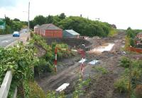 The site of Newtongrange station on 30 July looking south. The rain over the past week has created some additional water features here. The A7 runs past on the left.<br><br>[John Furnevel&nbsp;30/07/2013]