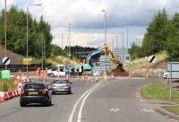 Approaching Hardengreen roundabout from the south on 30 July 2013 with work now underway on the roundabout itself [see image 42076].  <br><br>[John Furnevel&nbsp;30/07/2013]