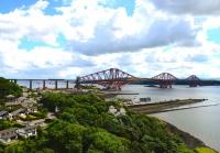 A view of the Forth Bridge taken from the Road Bridge on 30 July looking east over North Queensferry. A Turbostar is heading north into Fife.<br><br>[John Gray&nbsp;30/07/2013]
