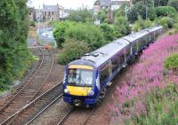 Northbound 170428 coasts downhill towards Inverkeithing station on 29 July 2013. Maintenance is being carried out in the background on the Rosyth Dockyard branch.<br><br>[Bill Roberton&nbsp;29/07/2013]