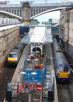 Work continues on the southernmost platforms at Waverley Station on 1 August, with 91009 and 334036 awaiting departure.<br><br>[Bill Roberton&nbsp;01/08/2013]