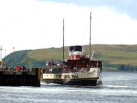PS <I>Waverley</I>, engine astern, prepares to berth at Largs Pier on 31 July 2013.<br><br>[Colin Miller&nbsp;31/07/2013]