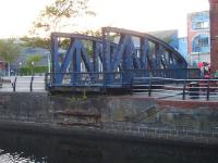 The truncated former railway swing bridge, sited next to <I>The Pumphouse</I> at the end of Gloucester Place, Swansea, in August 2013. The bridge once extended across the entrance channel to the large dock alongside the National Waterfront Museum's former Coast Lines transit shed.<br><br>[David Pesterfield&nbsp;01/08/2013]