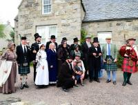 Some of the guests involved in the Strathspey Railway celebrations on 3 August 2013 [see image 44056] posing for photographs outside Grantown Museum in Victorian costume prior to the official opening. An exhibition about the railway is currently running here.<br><br>[John Gray&nbsp;03/08/2013]