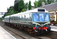 <I>The Cat's Whiskers!</I> The Strathspey Railway DMU played its part in the 150th anniversary celebrations and is seen here nicely turned out at Boat of Garten on 3 August 2013. [See image 44056]<br><br>[John Gray&nbsp;03/08/2013]