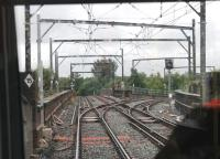 Metrolink driver's view of Irk Valley Junction, on a viaduct between Manchester Victoria and Woodlands Rd on the Bury line. The chord to the right closed in 1966 but was reinstated in 2012 for the Oldham and Rochdale Metrolink services. This junction was the scene of a major accident in 1953 when an EMU from Bury ran through a red signal and collided with a steam-hauled train on the crossover. The EMU fell from the viaduct and the driver and eight passengers were killed. <br><br>[Mark Bartlett&nbsp;31/07/2013]