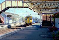 The 9.38 Glasgow Central - Stranraer runs non-stop through Prestwick Town station on 31 July 2013. <br> <br><br>[Colin Miller 31/07/2013]