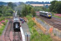 Looking east over Manuel Station on 6 August 2013, with the 12.55 to Boness waiting at the new platform behind 246 <I>Morayshire</I>.  Over on the right 170452 is passing on the E&G main line.<br><br>[Bill Roberton&nbsp;06/08/2013]