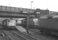 Diesel power dominates the north end of Carlisle station during the early afternoon of Saturday 7 December 1968. At platform 7 is BRCW Type 2 no D5312 on the 1.00pm Carlisle - Edinburgh Waverley via Hawick, a <I>Peak</I> is at 3 with the 1S49 10.25am Leeds - Glasgow Central via Dumfries, while Class 50 D409 is approaching platform 4 at the head of the 9.40am Perth - London Euston.<br><br>[K A Gray&nbsp;07/12/1968]