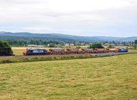 DRS 37218 and 37423 top and tail 5 autoballasters past Beauly on their way to Strathcarron on 8 August in preparation for overnight engineering works. <br><br>[John Gray&nbsp;08/08/2013]