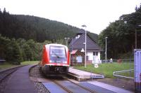 On 29th June 2013, a Schwartzatalbahn branch train arrives at the Katzhuette terminus of the 25km branch line from the Rottenbach junction on the Saalfeld-Erfurt line in Thuringen. The single-car VT641 diesel unit is a driver-only operation, with a ticket machine on the train. The grid in the foreground and the container to the right are part of a small refuelling point.<br><br>[David Spaven&nbsp;29/06/2013]