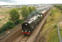 Britannia Pacific 70013 <I>Oliver Cromwell</I> hauls the second leg of the train commemorating the 45th anniversary of the <I>15 Guinea Special</I> from Manchester to Carlisle through Buckshaw Parkway station on 11 August 2013. Known to many as 1T57 - the reporting code used by the original train and also by this charter. [See image 26044]<br><br>[John McIntyre&nbsp;11/08/2013]