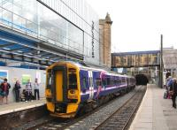 The east end of platform 1 at Haymarket on 9 August 2013, with the departing 11.00 Perth - Edinburgh Waverley about to enter Haymarket tunnel.<br><br>[John Furnevel&nbsp;09/08/2013]
